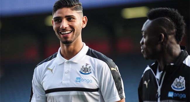 Achraf Lazaar Smiling and Christian Atsu Newcastle United