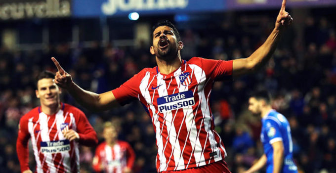 Atletico Madrid's Brazilian-Spanish striker Diego Costa (C) celebrates after scoring against Lleida during their King's Cup round of 16 first leg match at Camp D'esports stadium in Lleida, northeastern Spain, 03 January 2017.