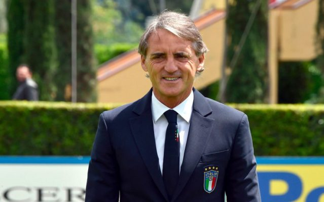 TOPSHOT - Italy's national football team newly appointed head coach, Roberto Mancini poses after a press conference on May 15, 2018 at the national team's training centre at Coverciano near Florence. - Italy head coach has the task of reviving Azzurri fortunes six months after their shock failure to qualify for the World Cup 2018 in Russia. Italy have been without a permanent coach since Gian Piero Ventura was sacked after the four-time world champions failed to qualify for the World Cup for the first time since 1958. (Photo by Carlo BRESSAN / AFP)        (Photo credit should read CARLO BRESSAN/AFP/Getty Images)
