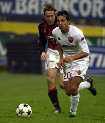 MILAN - DECEMBER 7:  Davide Bombardini of Roma in action during the Serie A match between AC Milan and Roma, played at the 'Giuseppe Meazza' San Siro Stadium, Milan, Italy on December 7, 2002.  (Photo by Grazia Neri/Getty Images)
