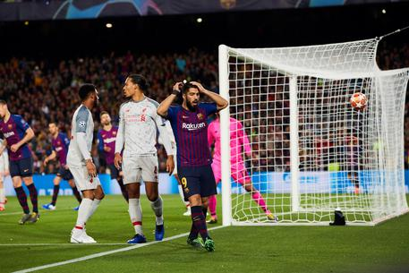 epa07541191 FC Barcelona's forward Luis Suarez reacts during the UEFA Champions League first leg semifinal match between FC Barcelona and Liverpool in Barcelona, Spain, 01 May 2019.  EPA/Alejandro Garcia